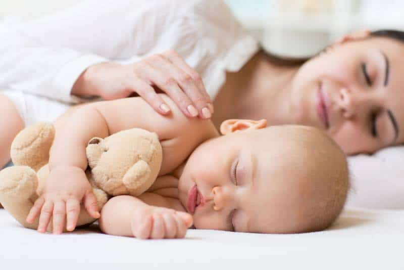 mom and her cute little baby sleeping