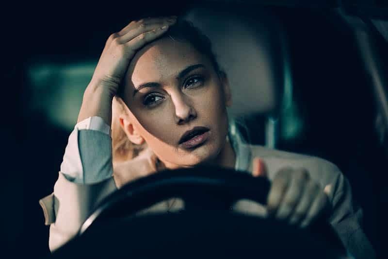 woman in car having postpartum rage