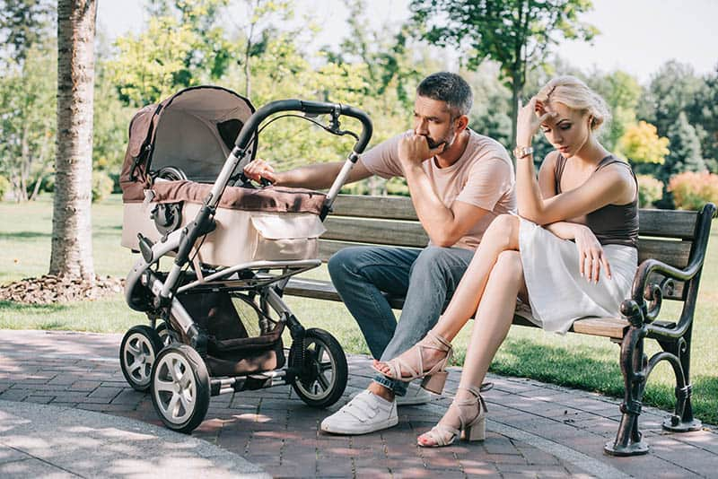 wife and husband with baby in park postpartum rage