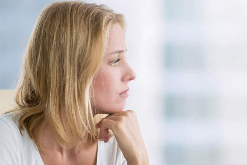 woman having postpartum rage sad look