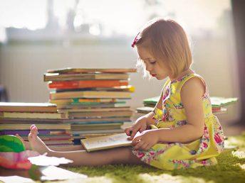 little girl reading stories for kids