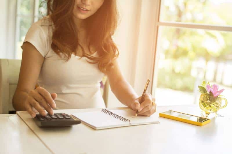 woman using the calculator and doing finances