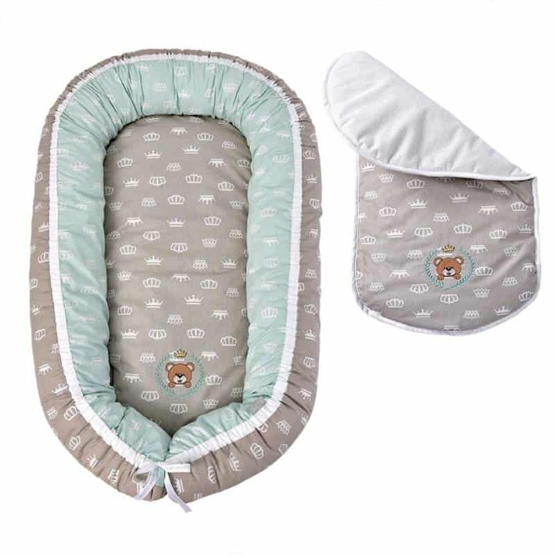 Cotton baby lounger with a slipcover on a white background