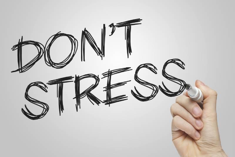 Don't stress message handwritten on whiteboard