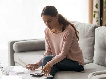 woman calculating paycheck
