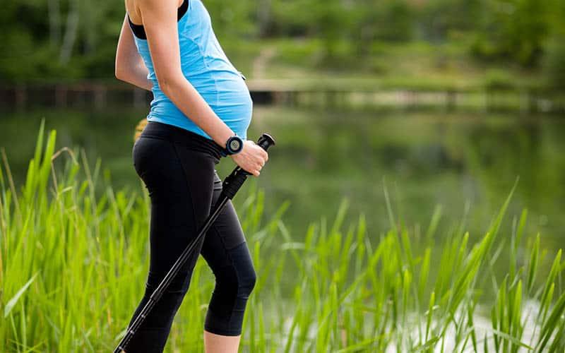 Pregnant woman walking taking a hike