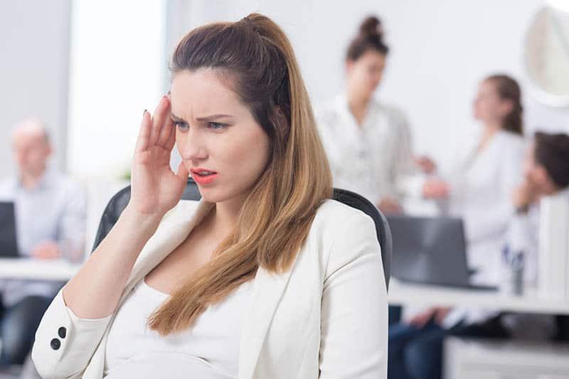 woman having headaches