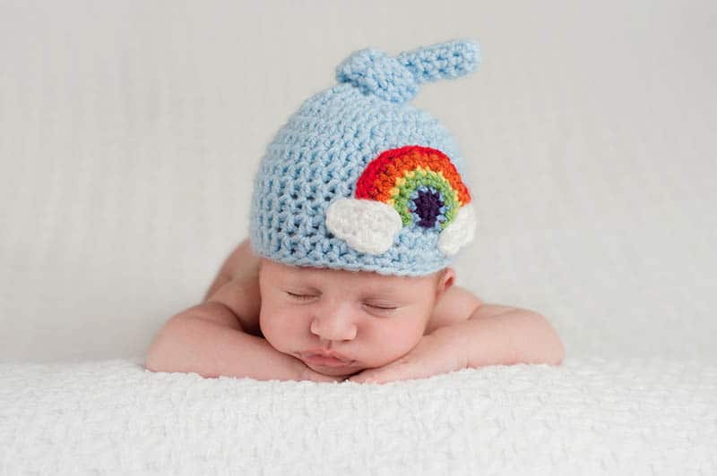 baby with blue cap