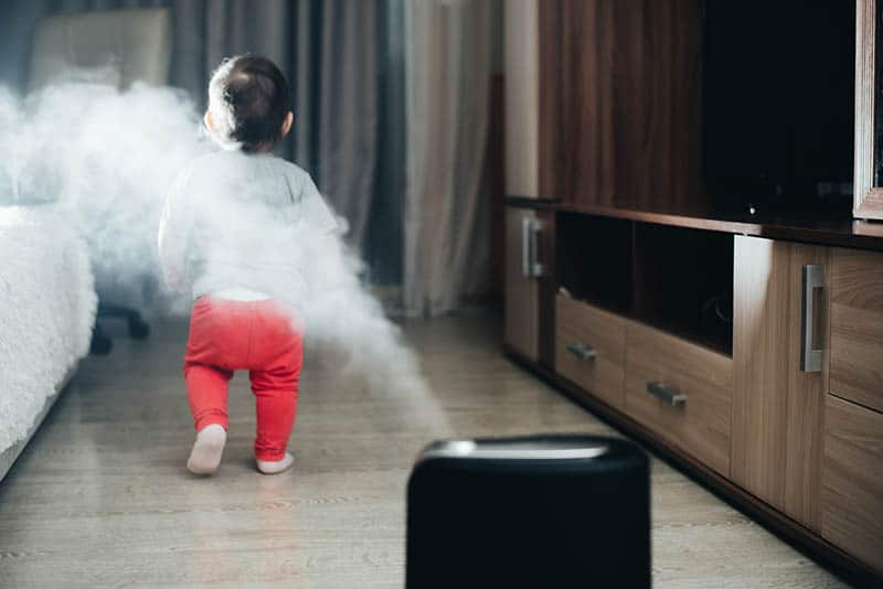 baby walking away from humidifier