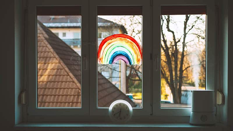 babies room window with rainbow drawing and humidifier