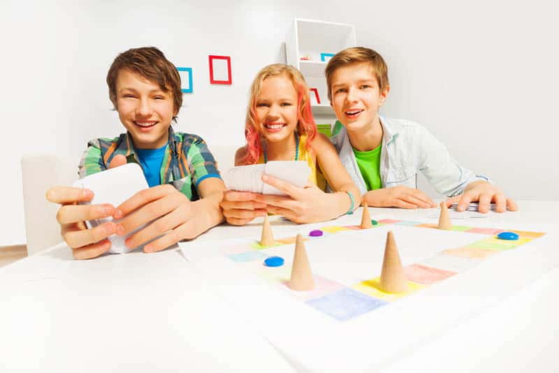 teens playing board games