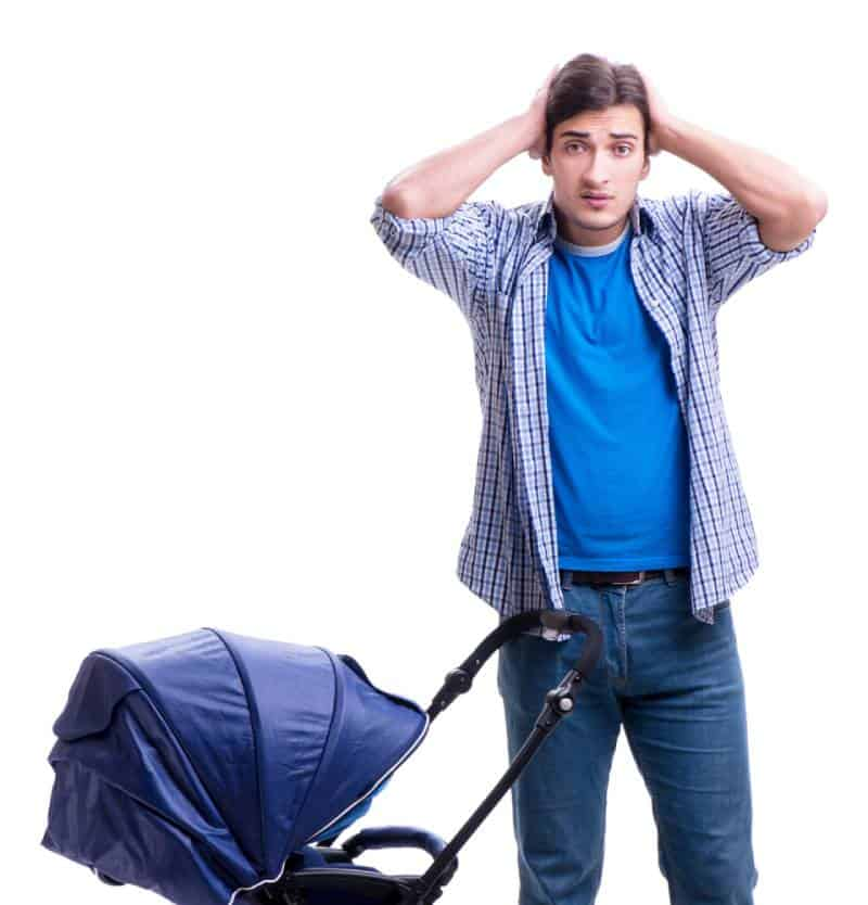 Confused dad with a baby in blue stroller on white background