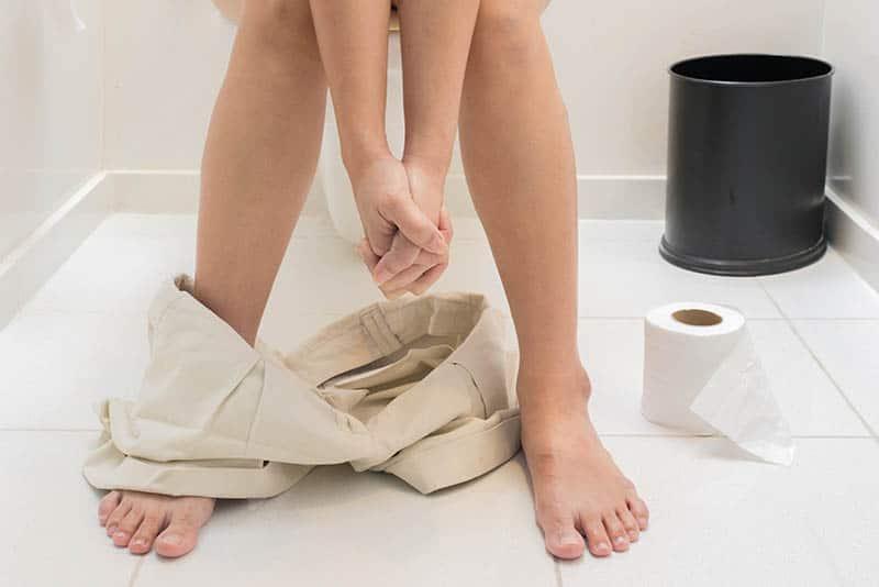 woman on toilet Diarrhea