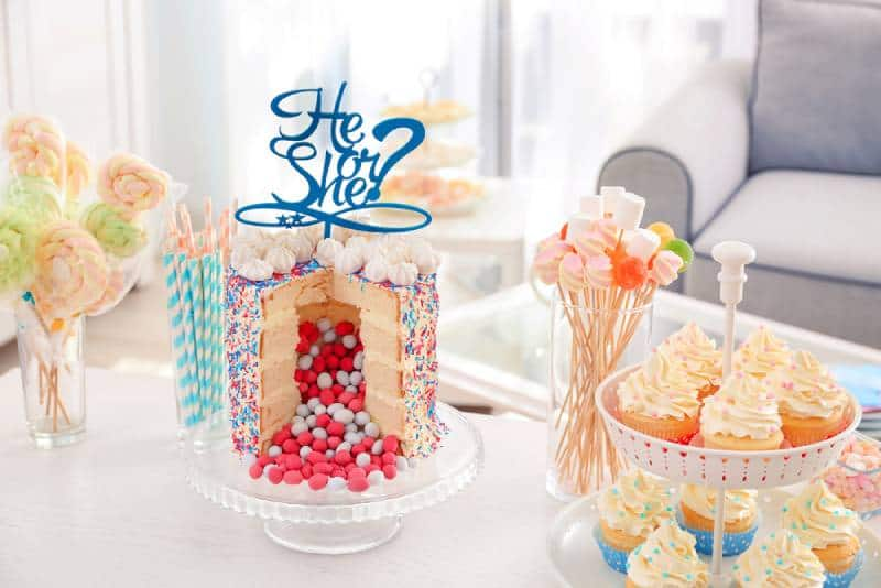 Tasty treats served for baby gender reveal party on table