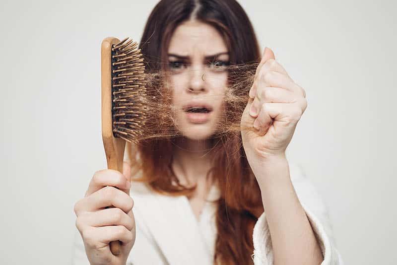 woman losing hair