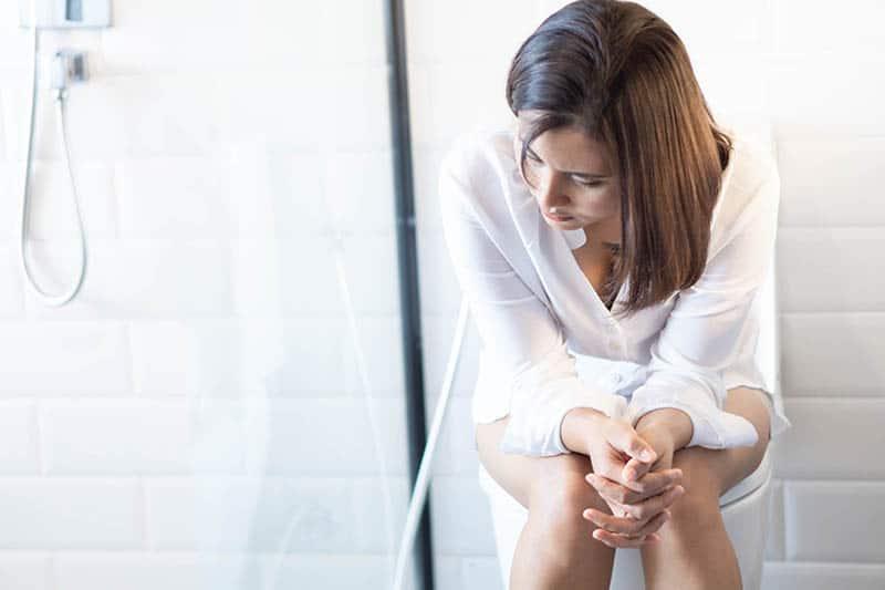 woman sitting on toilette Hemorrhoids