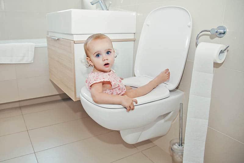 baby on potty having night time potty training