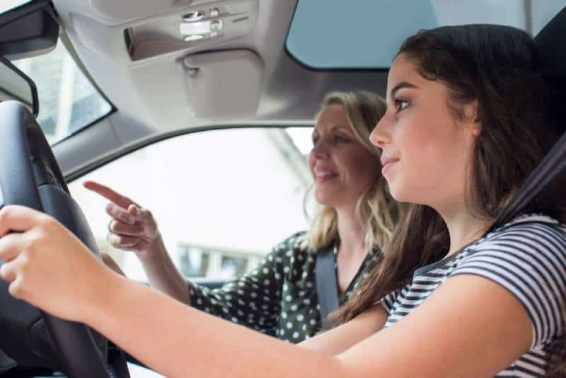 Teeneage girl is having a driving lessons with female instructor