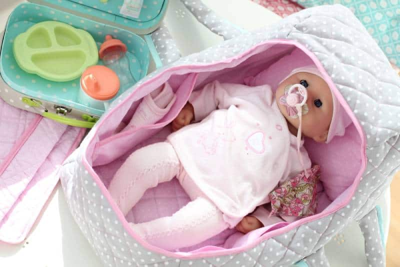 Baby doll with pink baby bag and carry bag