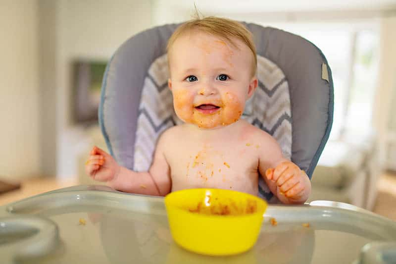 happy baby eating meat
