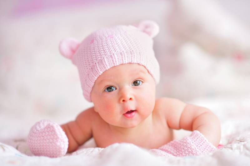 baby girl in a pink hat
