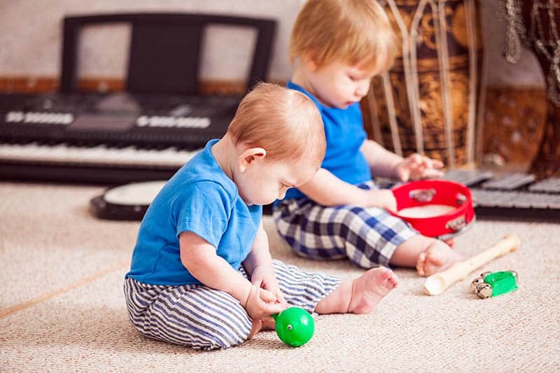 babies playing with musical instruments