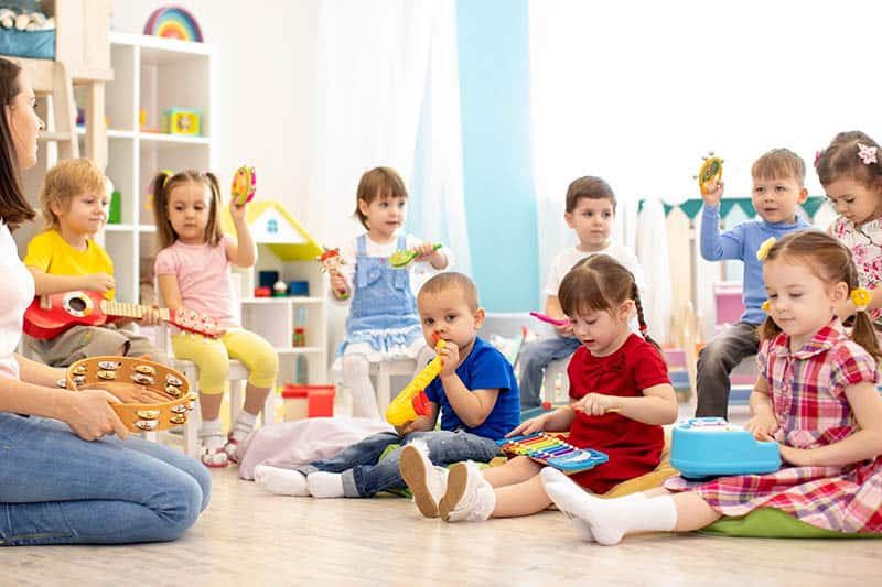 group of babies playing musical instruments