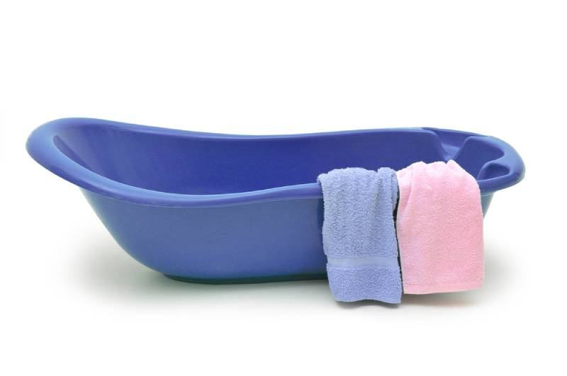 Purple baby bath with two towels on it