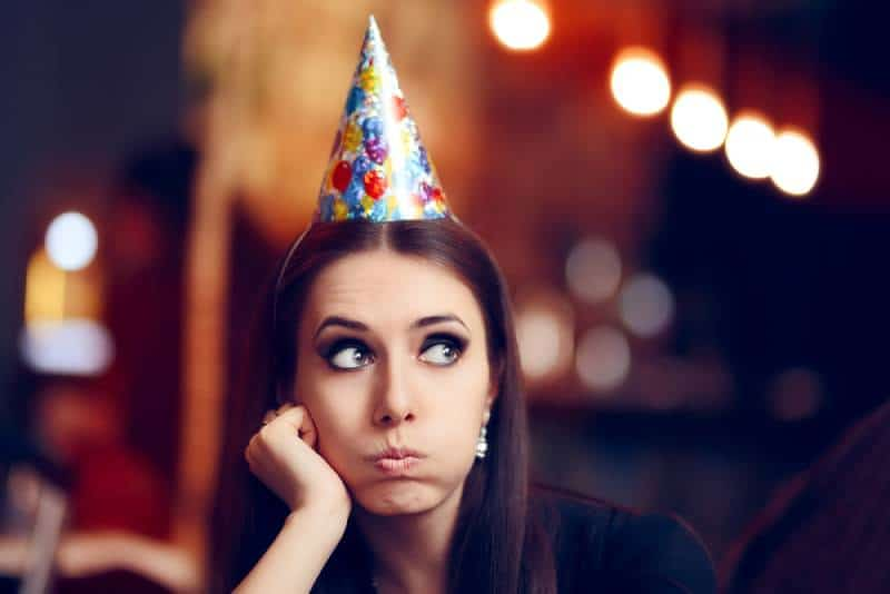 Bored woman doesn't want to attend the party