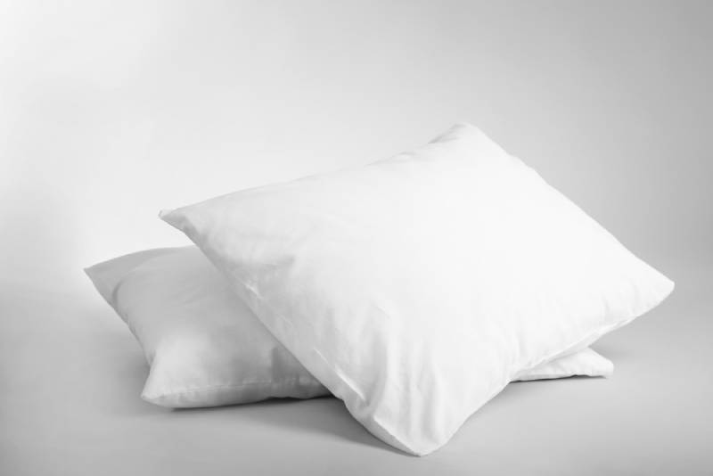 2 white pillows on grey background