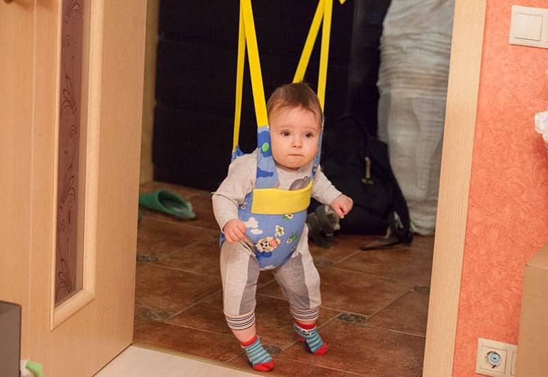 baby in doorway jumper