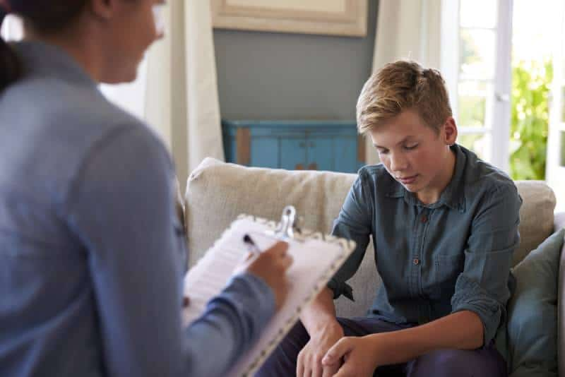 Teenager with behavioral problems at therapist's office