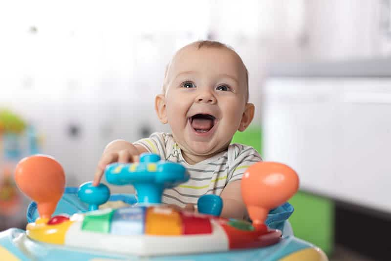 happy baby laugh in a baby jumper