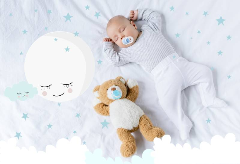 baby with pacifier sleeping on bed with teddy bear with cute moon illustration