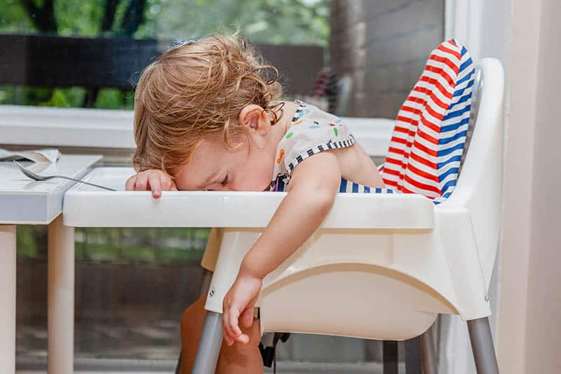 baby falling asleep on table while eating overtired