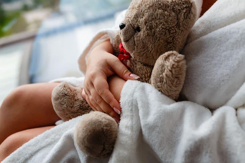 woman holding a teddy bear