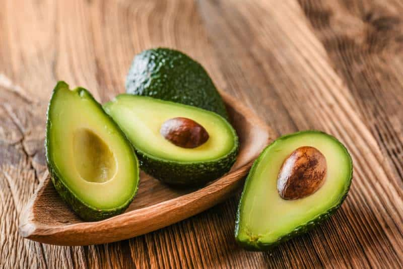 Avocado in a bowl on a wooden table