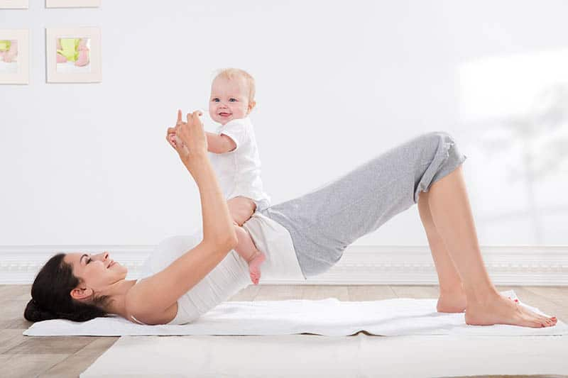 baby and mother doing yoga