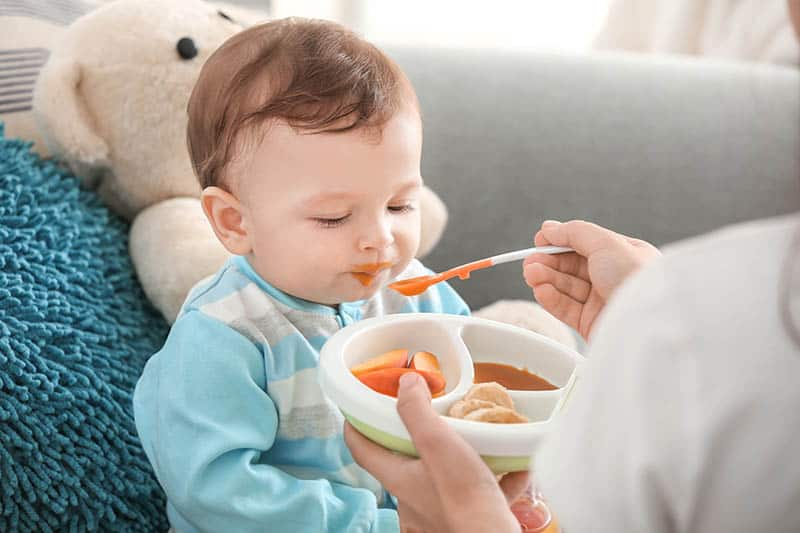 baby getting fed by mom for feeding therapy
