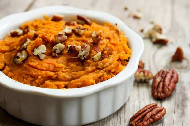 Mashed Sweet Potatoes with Pecans in a white bowl
