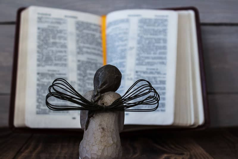 angel figure and book on the table