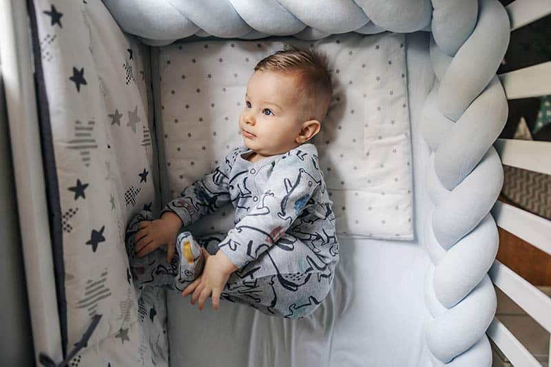 baby boy in grey footed pajama