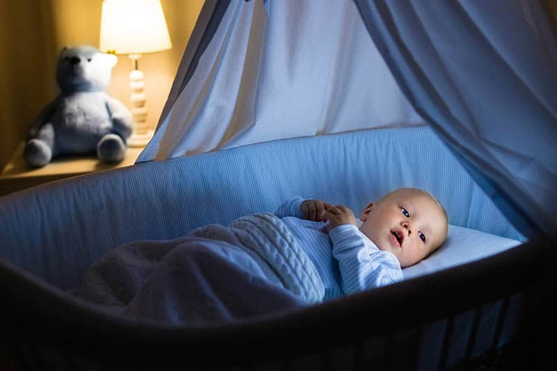 baby in a crib ready for night sleep