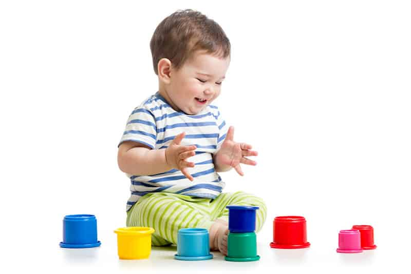 baby playing with cups