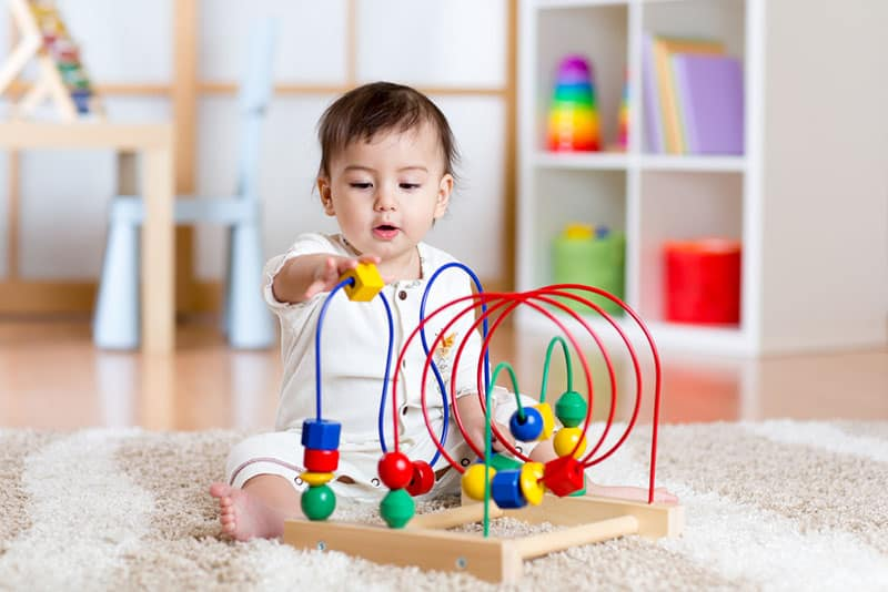 baby playing with educational toy