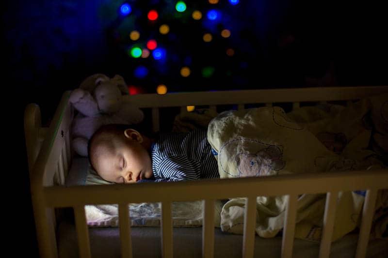 baby sleeping in a warm room at night