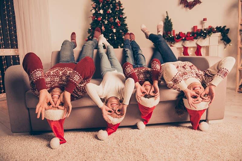 happy family at christmas goofing around telling christmas jokes for kids
