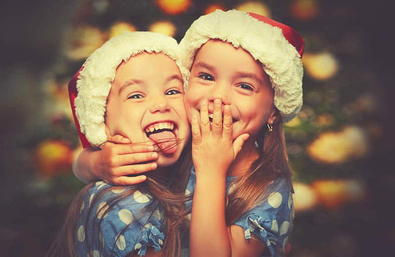 daughters laughing at jokes for christmas