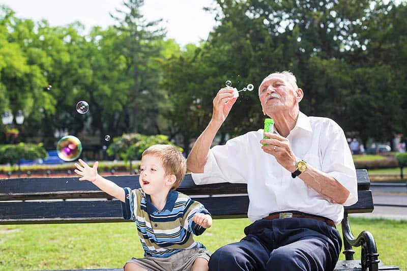 granddad with kid playing in park