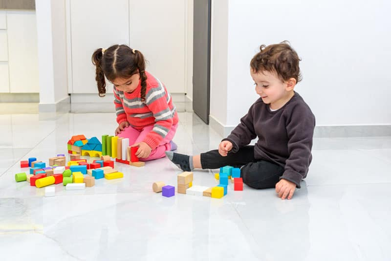 kids playing with toys on the floor